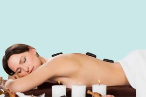 Relax and Refresh hero image, lady having hot stone massage